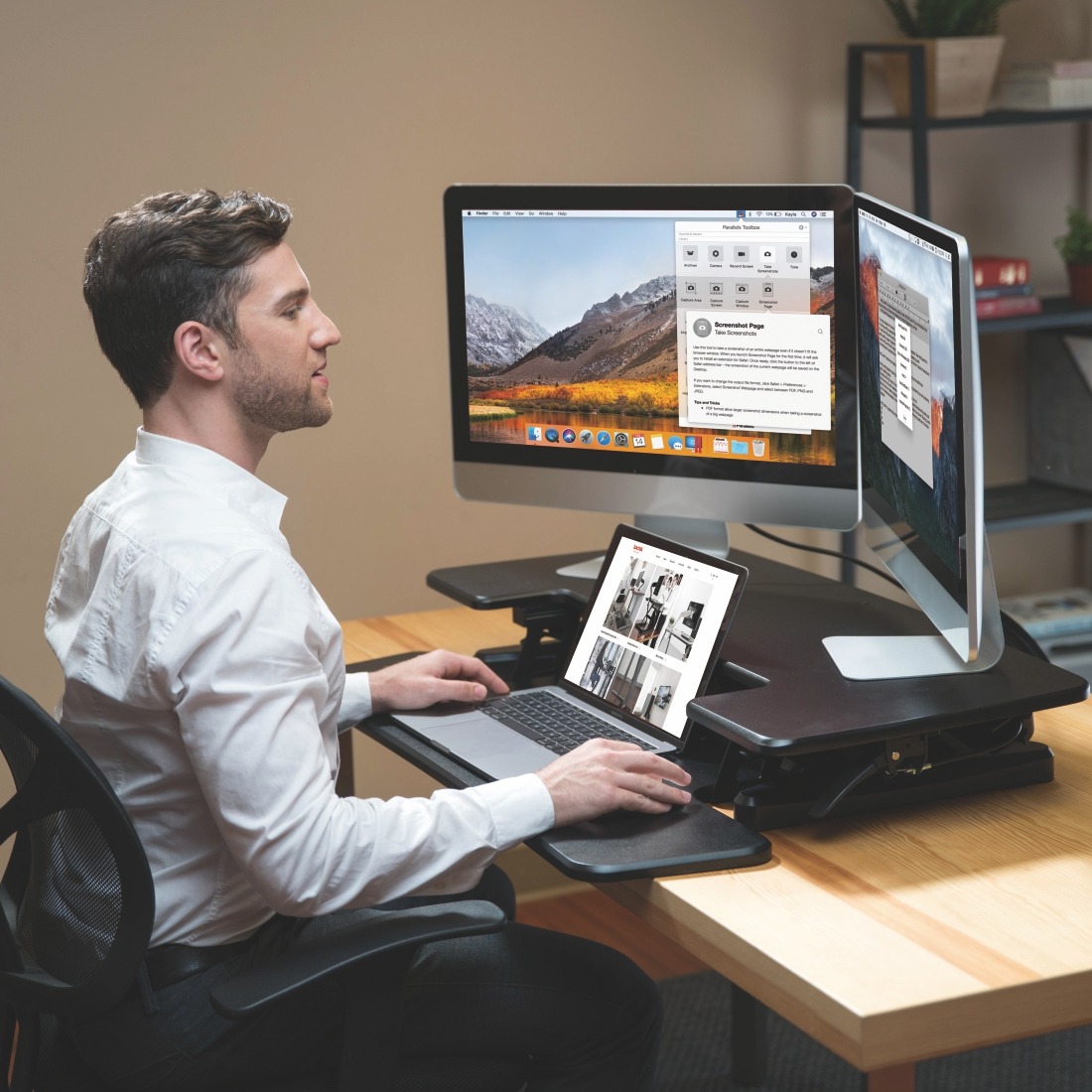 MT107M man sitting two large monitors and laptop